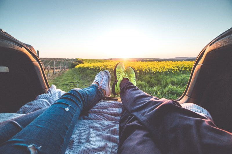 young-couple-enjoying-romantic-sunset-from-car-trunk-picjumbo-com